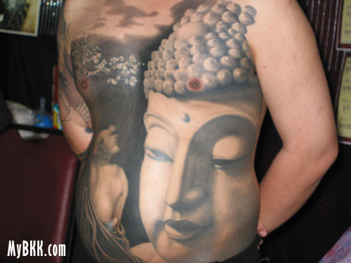 Thai Tattoo. I've got Budda in, errr…, on my belly and a lot of time to kill