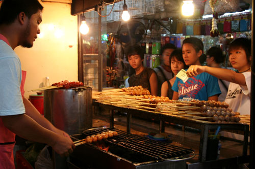 Fish-ball vendor, Chatuchak Weekend Market, Bangkok.