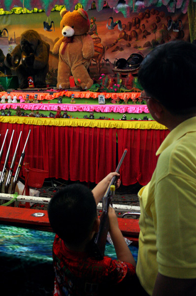 Boy at a shooting game, Golden Mount Temple Fair, Bangkok.